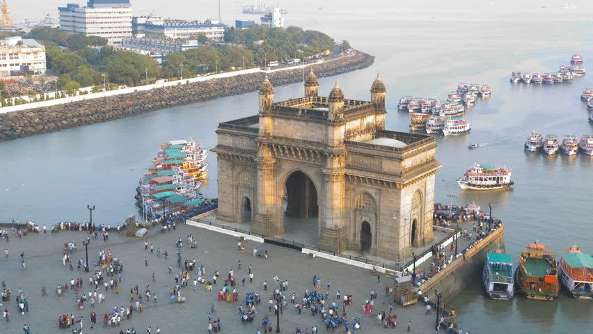 India - March 2015: Mumbai time lapse Gateway India Maharashtra Asia monument boat tower building sea city people Port