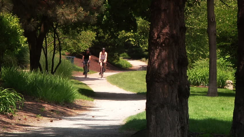 A young couple bike and sightsee on the bike trails on Washington's Landing, an