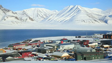 LONGYEARBYEN, SPITSBERGEN, NORWAY - APRIL 03, 2015: Small town on the shores of the Arctic ocean among snow-capped mountains of the Norwegian archipelago of Svalbard.
