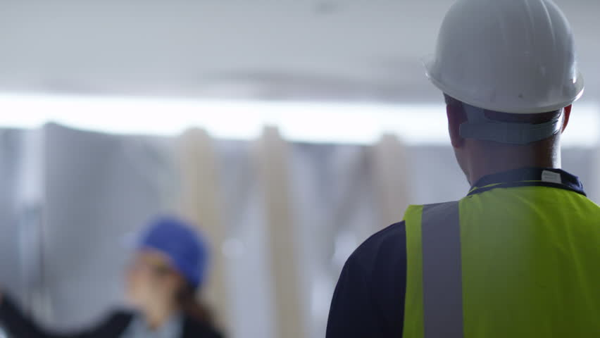 4k Confident female engineer or architect discussing construction issues with male colleague. Shot on RED Epic. | Shutterstock HD Video #12039839