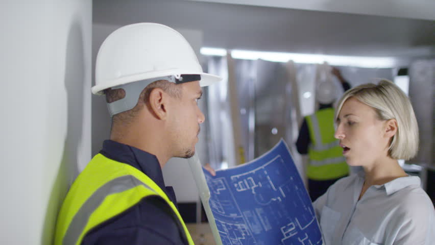 4k Confident female engineer or architect discussing construction issues with a male colleague. Shot on RED Epic. | Shutterstock HD Video #12042698