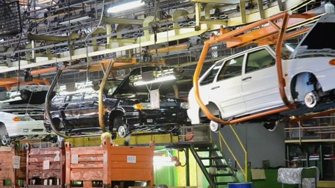 TOGLIATTI - SEP 30: People work at assembly of cars Lada Samara on conveyor of factory AutoVAZ, on September 30, 2011 in Togliatti, Russia. Time lapse