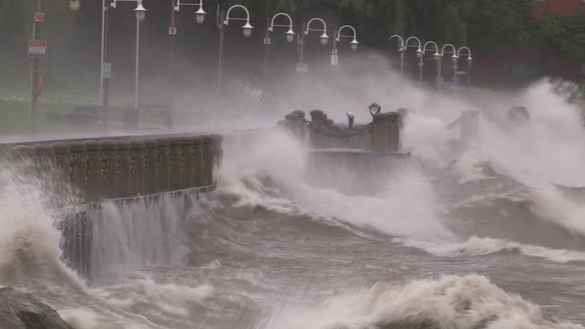 Huge powerful waves breaking at seawall in major severe storm.  | Shutterstock HD Video #12050762