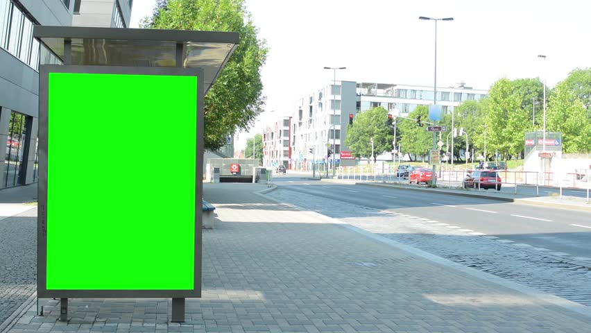 Bus stop with green screen billboard in the tranquil part of the city - cars slowly pass around   Shutterstock HD Video #12068417