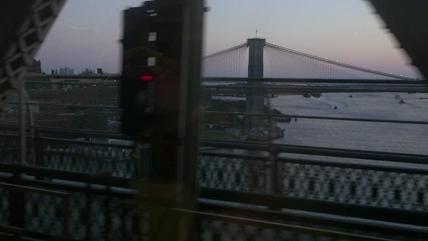 Slow motion Brooklyn bridge and Manhatten from new york subway