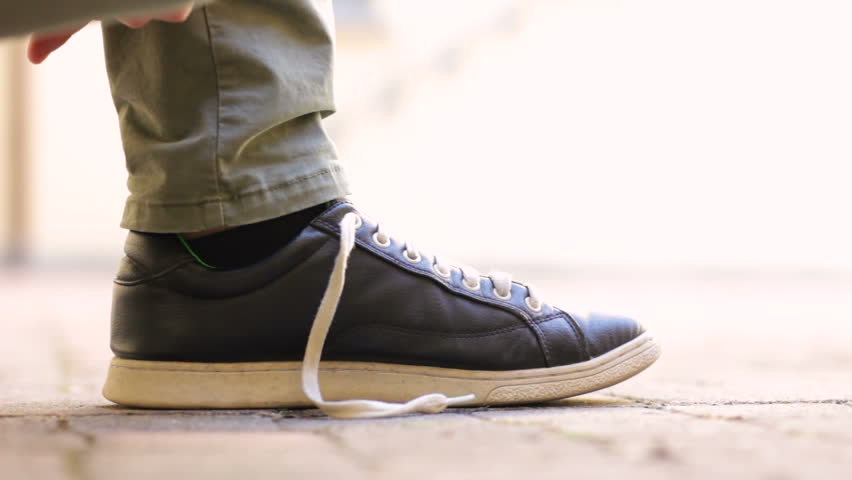 c037062b5601 Male Man Lacing up Shoes Stock Footage Video (100% Royalty-free ...