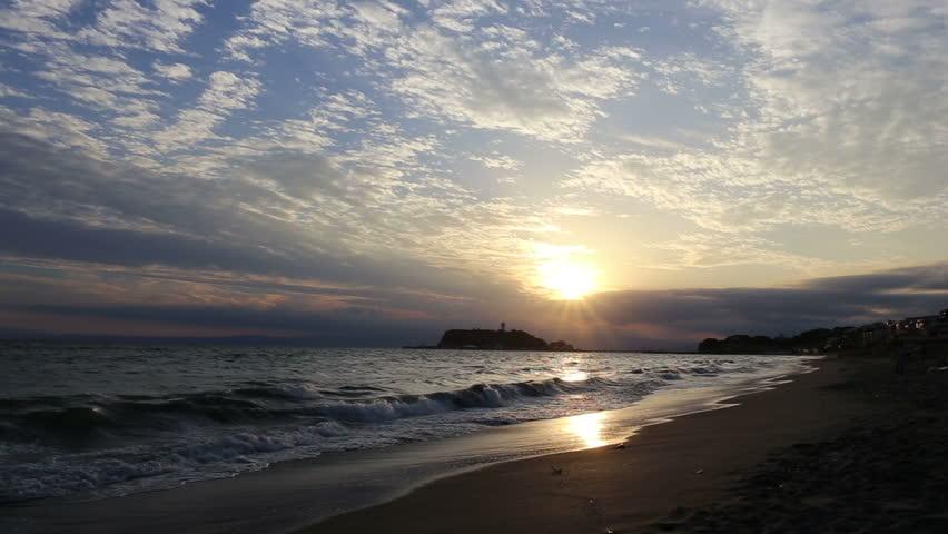 View Enoshima from Shichirigahama, coastline sunset at dusk with roar of waves, October 2015, kamakura City , Kanagawa Prefecture, Japan   Shutterstock HD Video #12107138