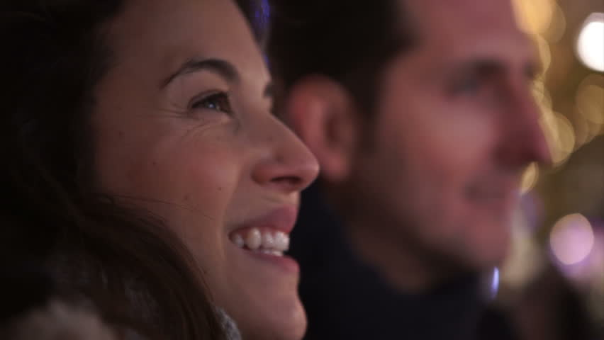 Close up of romantic couple kissing on city street at Christmas time. Shot on RED Epic. | Shutterstock HD Video #12108968