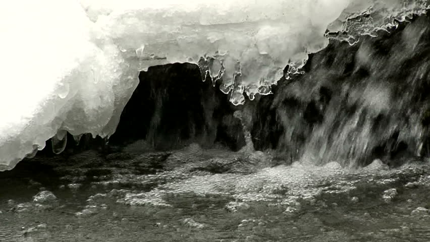 Closeup of ice in a waterfall dripping as it melts.