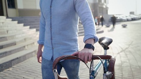 man on a bicycle with a smart clock