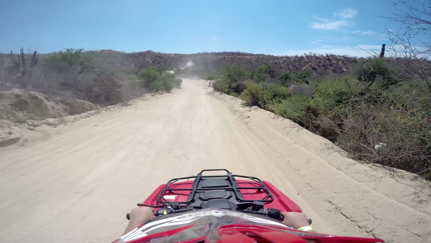 First person POV of a four wheeler driving on trails at the coast | Shutterstock HD Video #12178967