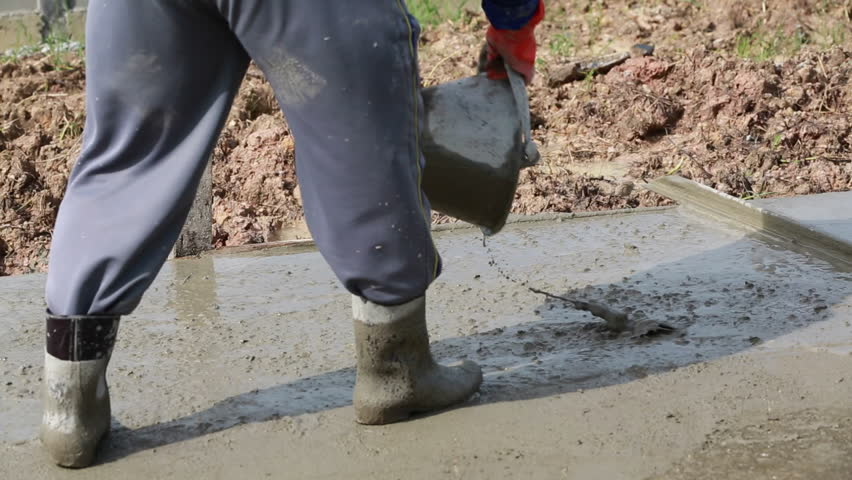 Pouring Cement Concrete Close Up Of Men Wearing Rubber