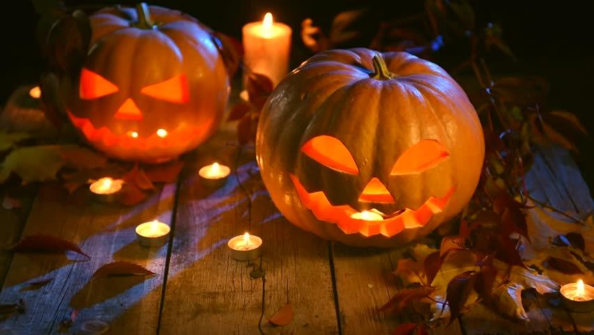 halloween pumpkin head jack lantern with burning candles over black background halloween holidays art design - Design Halloween