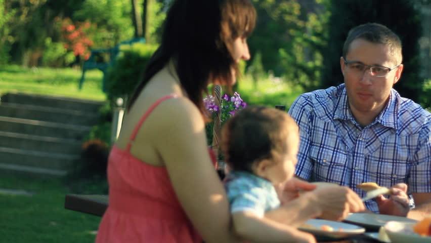 Family eating in the garden, dolly shot