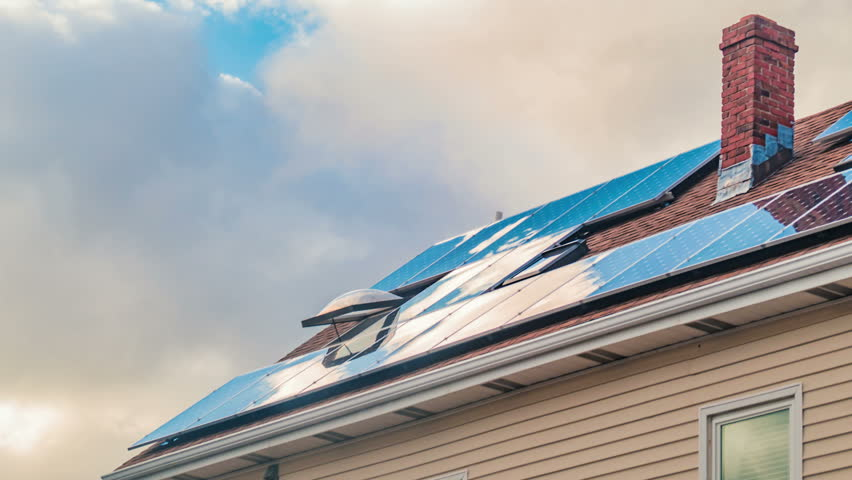 Solar panels on roof of residential house, clean green energy timelapse