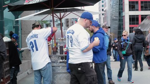 Toronto blue jay sports fans eating hotdog from stand - OCTOBER 14TH, 2015 - Toronto World Series Playoffs Game 5 vs Texas Rangers