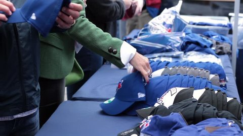 Toronto blue jays hats merchandise close up table - OCTOBER 14TH, 2015 - Toronto World Series Playoffs Game 5 vs Texas Rangers