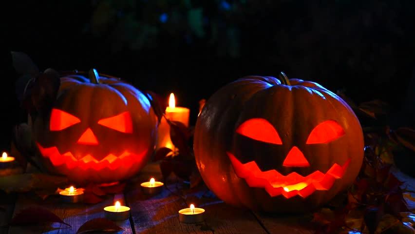 Halloween pumpkin head jack lantern with burning candles over black background. Halloween holidays art design, celebration. Stock video footage HD 1080p  | Shutterstock HD Video #12261236