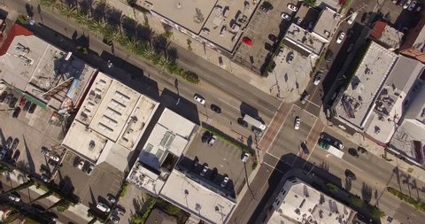 Vertical aerial top down view shot rotating, descending and looking down on street traffic in Los Angeles, California. 4K UHD.