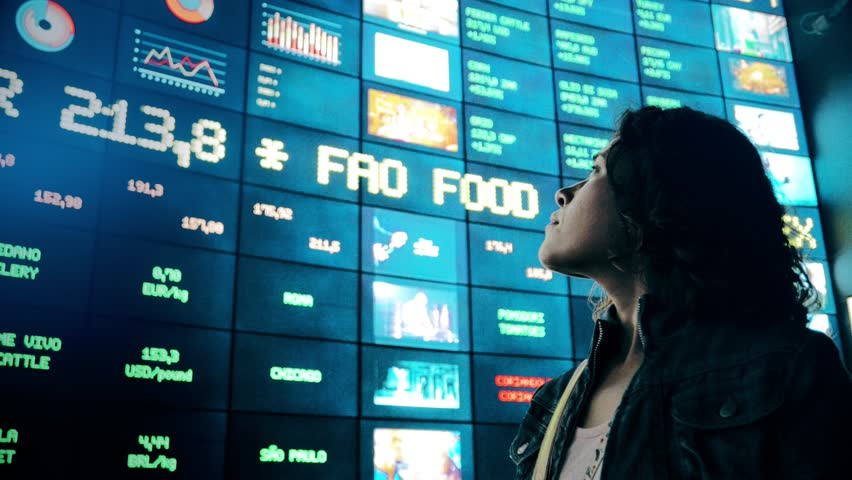 Hispanic woman observing information in a video wall made id flat screens. 4k | Shutterstock HD Video #12330569
