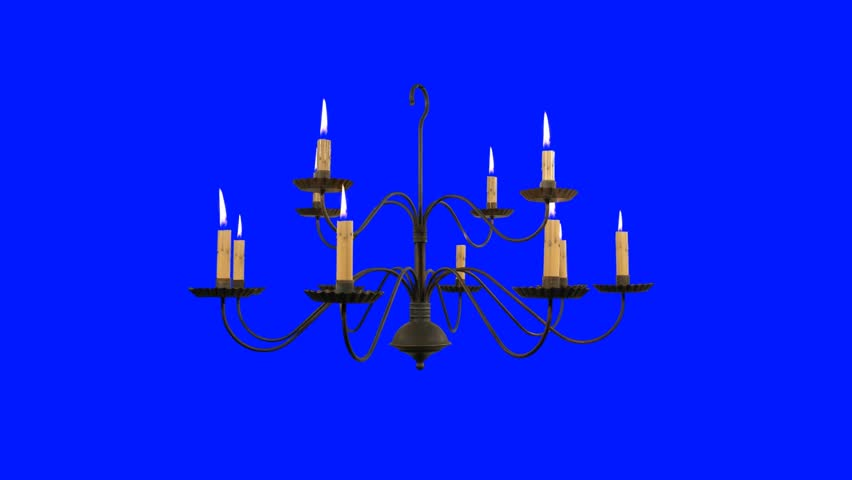 Candle in a vintage chandelier cell timelapse on a green old chandelier with burning candles on a blue background hd stock footage clip aloadofball Gallery