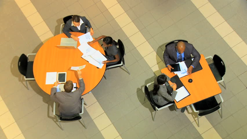 Multi ethnic business male female businessman businesswoman financial advisor wireless technology laptop tablet stock trading marketing | Shutterstock HD Video #12333248