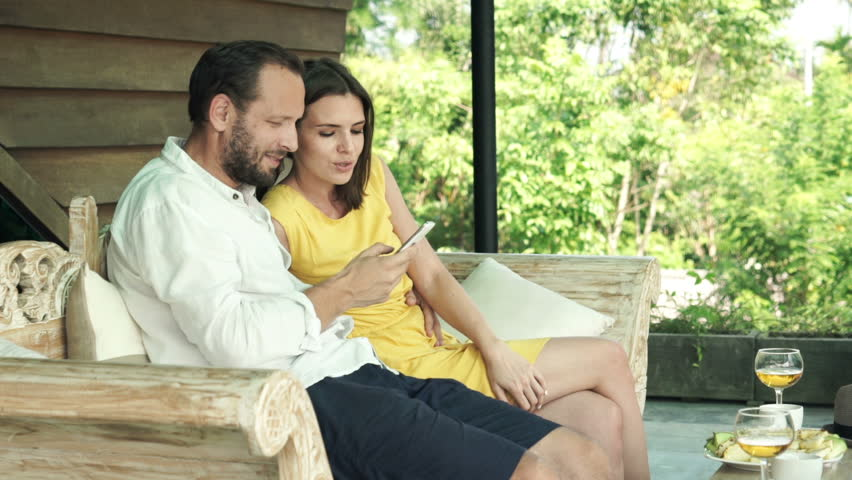 Young couple talking photo with cellphone on terrace  | Shutterstock HD Video #12366428