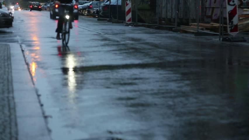 Yellow Reflections Of Bike Headlights On Wet Pavement Stock