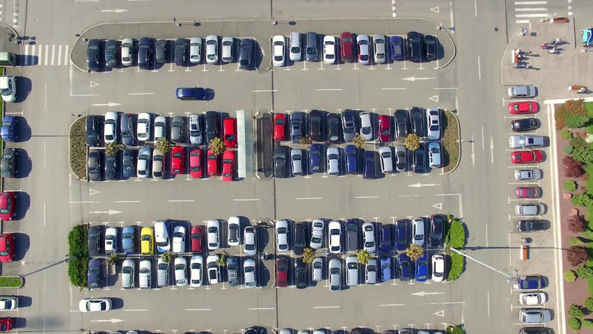 Flying over a parking lot full of cars, aerial view taken by a professional drone | Shutterstock HD Video #12413138