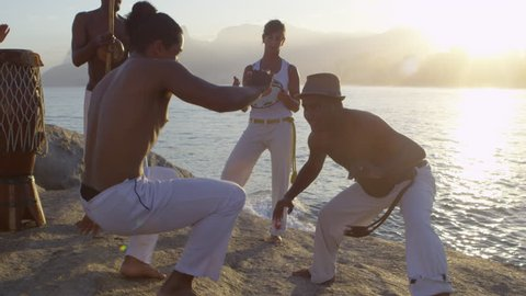 Capoeira group practicing by the beach