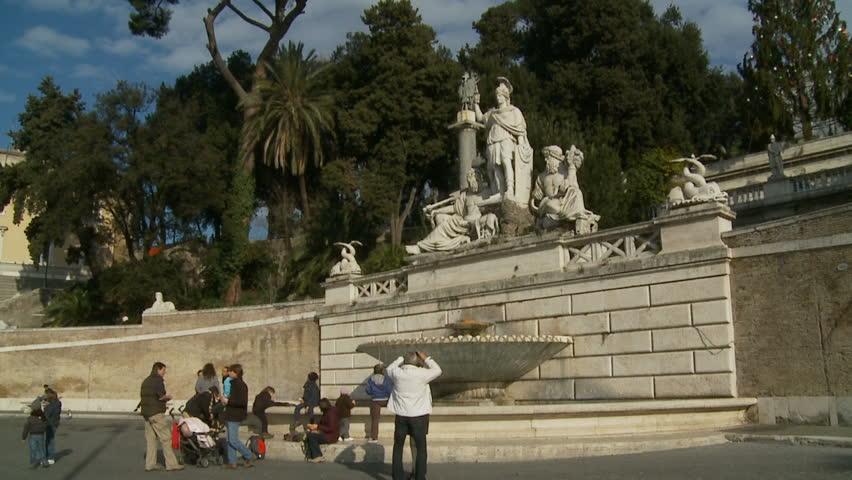Glidecam Piazza Del Popolo Fountain (2) With Tourists. Rome, Italy. 2011