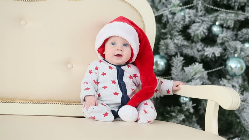 Christmas Baby Images Hd.Baby In Santa Hat Sits Stock Footage Video 100 Royalty Free 12465098 Shutterstock