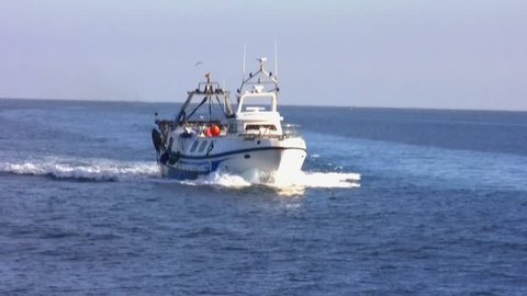 ALICANTE, SPAIN – OCTOBER 18: The trawlers fishing boat return to Santa Pola harbor to sale their captures in open waters in Alicante coast; on october 18, 2015 in Alicante.
