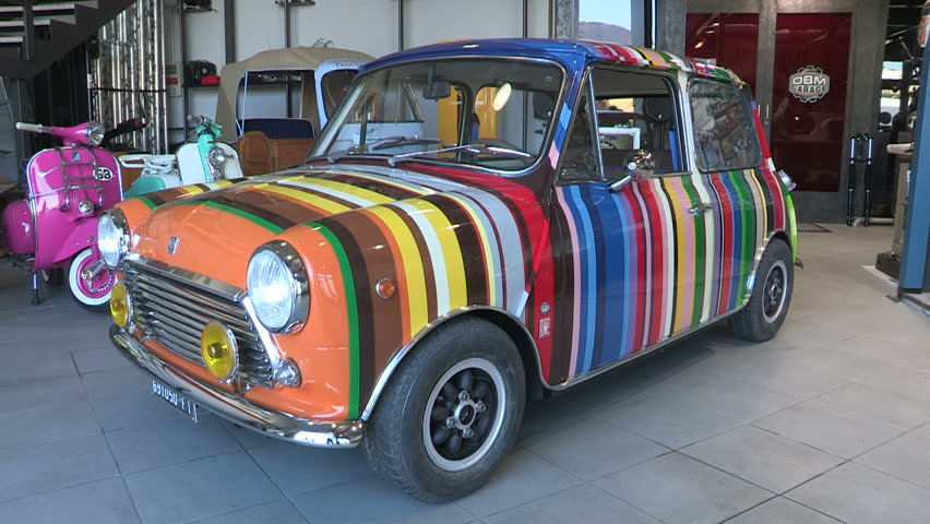 A Colorful Vintage Mini Car In An Italian Work
