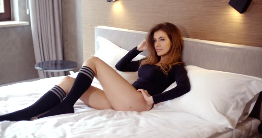 Sensual Girl Relaxing In Her Bedroom She Wearing Black Bodysuit And Socks Smiling Slow Motion Video