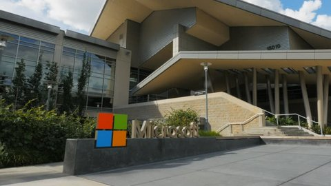 REDMOND, WASHINGTON, USA- SEPTEMBER 3, 2015:panning exterior view of microsoft headquarters building.