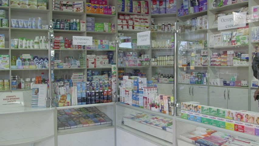 SIMFEROPOL, RUSSIA - CIRCA OCTOBER 2015: Shelves full of medications in pharmacy drugstore pan shot | Shutterstock HD Video #12502208
