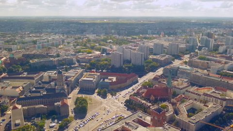 Aerial view of busy street intersection in Berlin. Cars stop at traffic lights