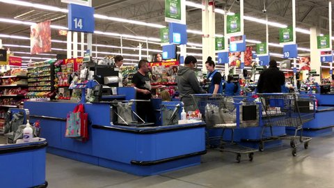 Port Coquitlam, BC, Canada - October 30, 2015 : People paying foods at check out counter inside Walmart store with 4k resolution