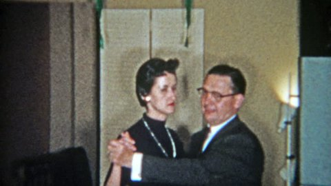 FT. WORTH, TEXAS 1956: Womanizing man dancing flirting with 3 different women in 1 night.