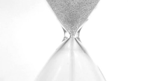 Hourglass closeup over white
