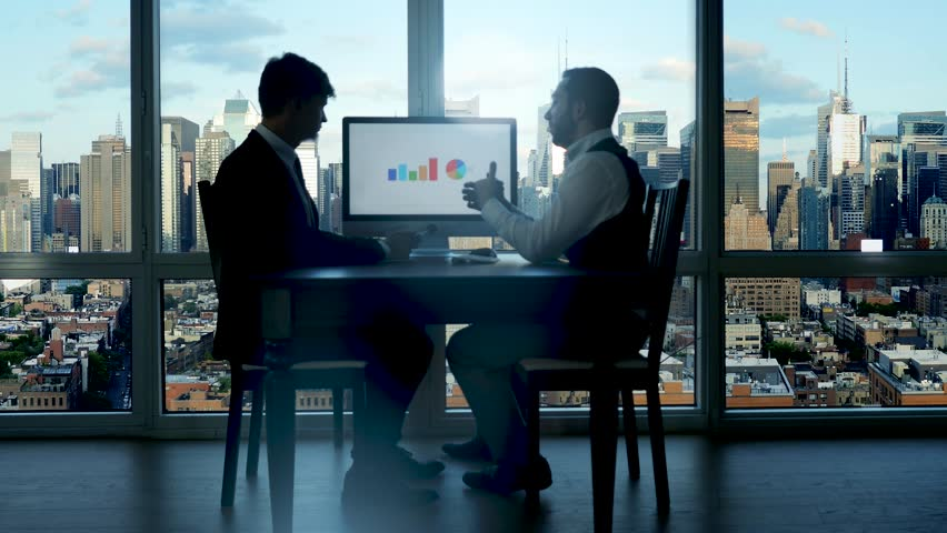 business people having a meeting conference talking about future success of the company. modern city office interior. charts and diagrams background