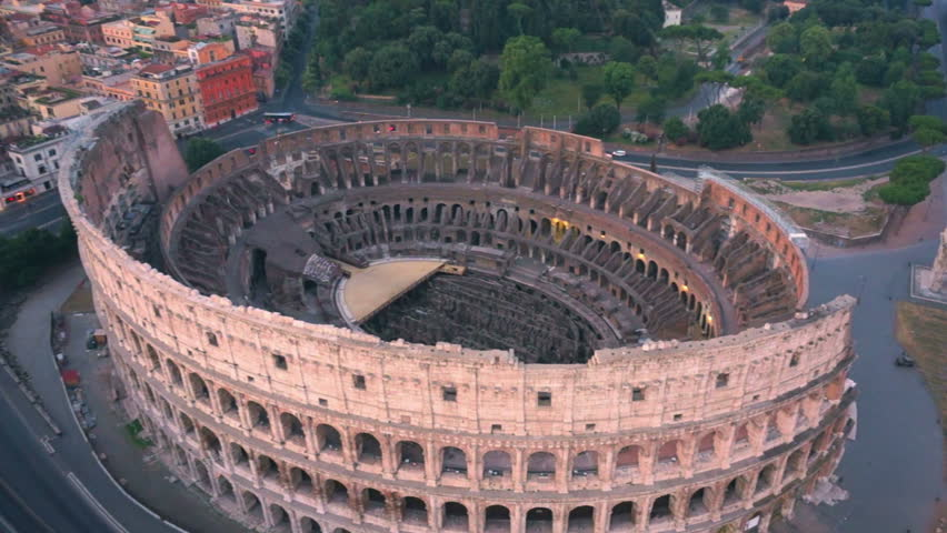 17 September 2015 :Colosseum, Rome, Italy. Aerial Roman Coliseum on sunrise. Beautiful view of the famous Italian landmark travel icon in the Roman forum.