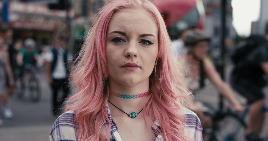 Slow Motion Portrait of caucasian girl with pink hair in city real people series
