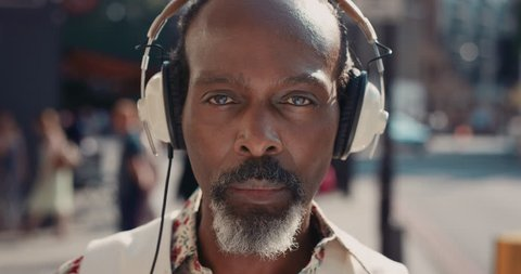 Slow Motion Portrait of mature african american man in city listening to music real people series