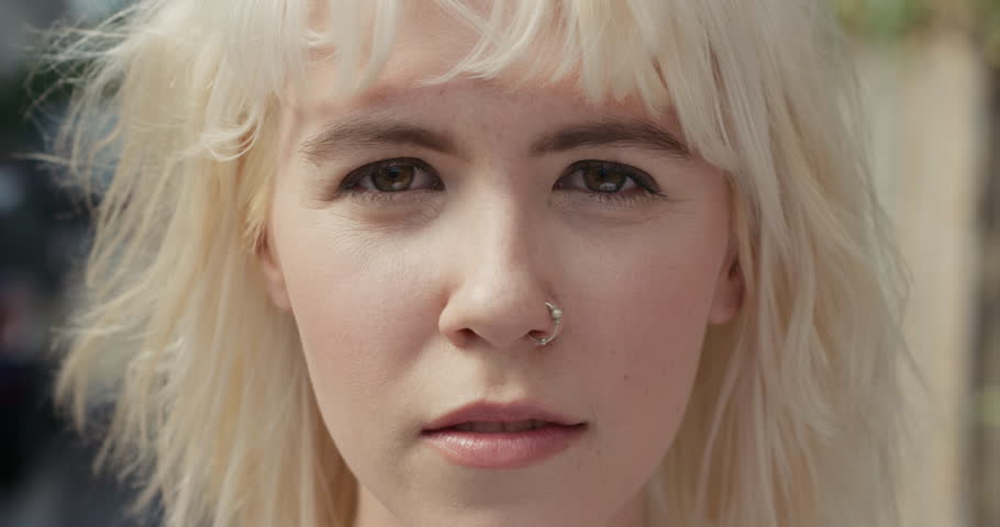 Close up Slow Motion Portrait of beautiful caucasian woman wearing nose ring in the city real people series