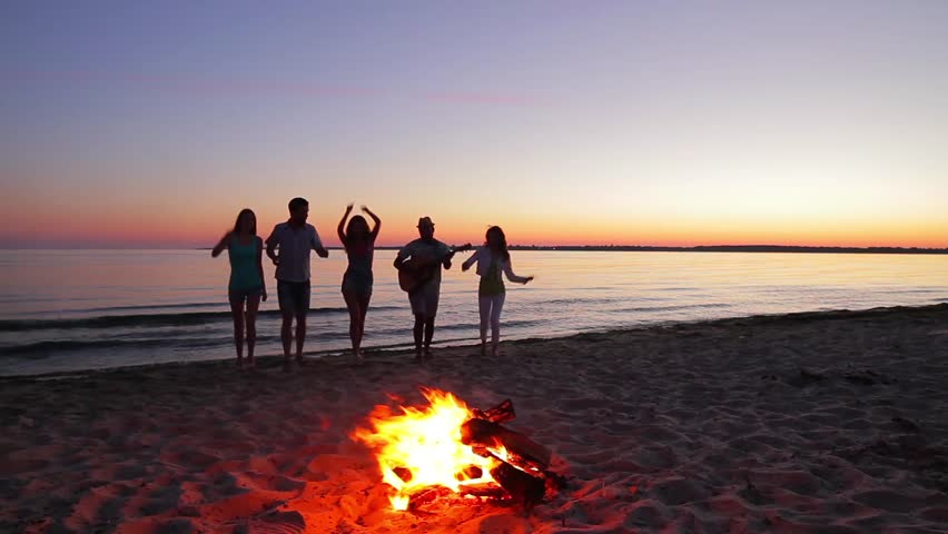 Young People Dance And Sing On The Beach Camping Island
