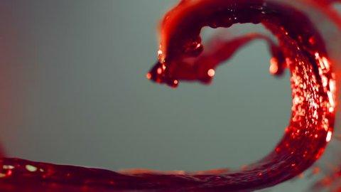wave of red wine, grape juice, pomegranate juice, raspberry juice, cherry juice , slow motion, white background