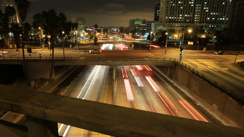 Sliding time-lapse shot above bridge railing revealing freeway traffic  | Shutterstock HD Video #1278148