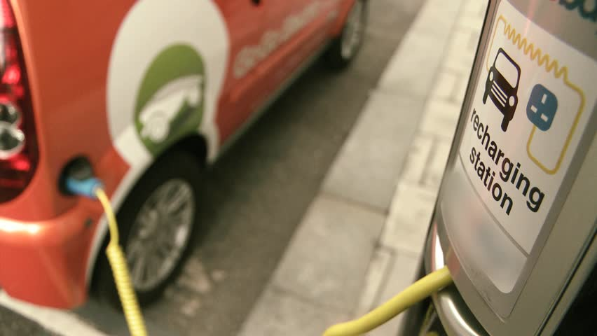 Electric car wired to charging station  | Shutterstock HD Video #1278253